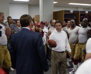 Head Coach Steve Mariucci presents 49er owner John York with the game ball in celebration of York's first divisional championship. Texas Stadium, December 8, 2002