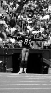 Terrell Owens celebrates a 49er TD on the Cowboys star at mid-field, 49ers vs. Cowboys, Texas Stadium, September 2000